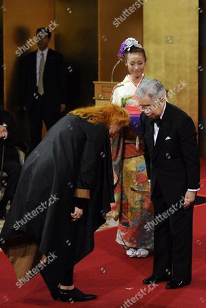 German Sculptor Rebecca Horn (l) Bows Before Japanese Prince Hitachi During the 22nd Praemium Imperiale Awards Ceremony in Tokyo Japan 13 October 2010 Horn was Awarded the Praemium Imperiale Arts Prize For Her Work in Sculpture the Award is Presented Annually by the Japan Art Association For Painting Architecture Sculpture Music and Theater/film Japan Tokyo