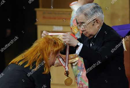 German Sculptor Rebecca Horn (l) Bows As She Receives a Medal From Japanese Prince Hitachi During the 22nd Praemium Imperiale Awards Ceremony in Tokyo Japan 13 October 2010 Horn was Awarded the Praemium Imperiale Arts Prize For Her Work in Sculpture the Award is Presented Annually by the Japan Art Association For Painting Architecture Sculpture Music and Theater/film Japan Tokyo