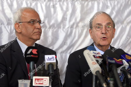 Chief Palestinian Negotiator Saeb Erekat (l) and Us Middle East Peace Envoy George J Mitchell During a Statement Following Their Meeting with Palestinian President Mahmoud Abbas in Amman Jordan on 22 March 2010 Mitchell Met in Jerusalem Yesterday 21 March with Israeli Prime Minister Benjamin Netanyahu Kicking Off the 'Indirect Talks' Meant to Lead to Direct Talks with the Palestinian Side Atfter a Break of a Week Due to the Controversary Over Israel's Expansion Building Plans For Arab East Jerusalem Jordan Amman