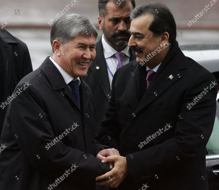 Pakistan's Prime Minister Yousaf Raza Gillani (r) and Kyrgyzstan's Prime Minister Almazbek Atambayev (l) Shake Hands During Their Meeting in Bishkek Kyrgyzstan 15 March 2011 Yousaf Raza Gillani is on an Official Visit in Kyrgyzstan Kyrgyzstan Bishkek