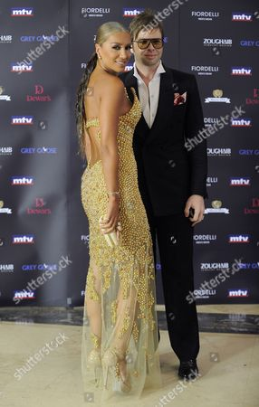 Lebanese Singer Maya Diab (l) and Lebanese Designer Nicola Gebran (r) Arrive to Attend the 11th Murex D'or Awards Ceremony Held at the Casino Du Liban in Murex D'or Awards Ceremony Northern Beirut Lebanon 23 June 2011 the Murex D'or Event is an Annual Award Ceremony Honoring the Best Singers and Actors of Lebanese and Arab Artists in Various Fields Lebanon Adma