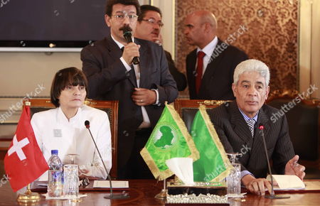 Stock Photo of Swiss Foreign Minister Michelle Calmy-rey (l) and Her Libyan Counterpart Mousa Kousa (r) Look on During the Signing of an Agreement Between Switzerland and Libya in Tripoli Libya 13 June 2010 Calmy-rey and Her Spanish Counterpart Miguel Angel Moratinos Arrived in Tripoli Late 12 June Their Official Trip was Organized After the Release on 10 June of the Swiss Businessman Max Goeldi who was at the Centre of a Dispute Between Libya and Switzerland Calmy-rey and and Her Libyan Counterpart Moussa Koussa Signed an Agreement 13 June on the Relations Between the Two Countries According to Local Media Sources No Details of the Agreement Were Immediately Available Libyan Arab Jamahiriya Tripoli