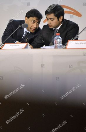 Lakshmi Mittal (l) Chairman of the Board of Directors and Chief Executive Office Chats with Aditya Mittal Group Chief Financial Officer Principal Accounting Officer Director of Finance and Member of Group Management Board of the World's Largest Steel Company Arcelormittal During a Results Press Conference at the Company Headquarters in Luxembourg 08 February 2011 Arcelormittal Announced Results For the Three and Twelve Month Periods Ended December 31 2010 Luxembourg Luxembourg