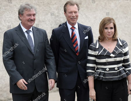 Luxembourg's Foreign Minister Jean Asselborn (l) Welcomes Luxembourg Grande Duchess Maria Theresa (r) and Luxembourg Grand Duke Henri (c) During 25th Anniversary of the Schengen Treaty in Schengen Luxembourg 13 June 2010 the Schengen Agreement is a Treaty Signed in 1985 on the River-boat 'Princess Marie-astrid' Between Five of the Ten Member States of the European Community Luxembourg Schengen