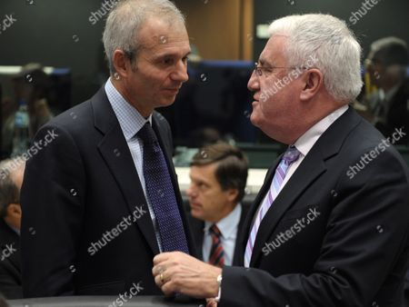 Stock Picture of Britain's Minister For Europe David Lidington (l) Chats with Irish European Affairs Minister Dick Roche (r) at the Start of a General Affairs Council in Luxembourg 25 October 2010 Luxembourg Luxembourg
