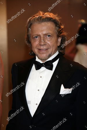 Italian Singer Umberto Tozzi Arrives at the 62nd Red Cross Ball at the Sporting Club Salle Des Etoiles in Monaco 30 July 2010 the Red Cross Ball is a Traditional and Annual Charity Event in the Principality of Monaco Monaco Monaco