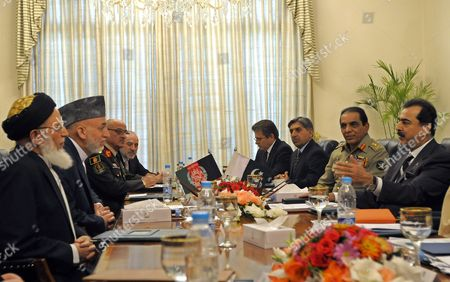 Afghanistan's President Hamid Karzai (2l) and Pakistani Prime Minister Yusuf Raza Gilani (r) with Their Respective Delegations Speak During Their Meeting in Islamabad Pakistan on 11 June 2011 Attending the Meeting Are Burhanuddin Rabbani (l) Former Afghan President and Now Head of Afghan High Peace Council General Karimi (3l) Chief of Afghan Army Mohammad Umer Daudzai (4l) Afghan Ambassador to Kabul General Ashfaq Pervez Kayani (2r) Pakistani Army Chief General Ahmed Shuja Pasha (3r) Director General of Pakistan's Premier Intelligence Agency Inter Services Intelligence (isi) and Muhammad Sadeq (4r) Pakistani Ambassador to Islamabad Afghan President Hamid Karzai Arrived in Pakistan on 10 June to Discuss Cross-border Attacks by Militants and Options to Increase Military Cooperation and Intelligence Exchange in the Fight Against Islamist Extremists Pakistan Islamabad
