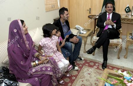 Pakistan's Interior Minister Rehman Malik (r) Talks with Pakistani Cricketer Zulqarnain Haider and His Family in Islamabad Pakistan on 25 April 2011 Upon Haider's Return From Britain Following an Assurance That the Pakistani Government Has Assured to Provide Fool Proof Security to Him and His Family Zulqarnain Haider the Former Pakistani Wicketkeeper Fled to Britain From Dubai in November 2010 During a One-day International Cricket Series Against South Africa Saying Hed Received Death Threats From Match Fixers Pakistan Islamabad