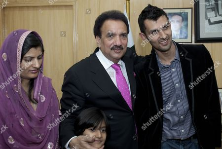 Stock Image of Pakistan's Interior Minister Rehman Malik (c) Talks with Pakistani Cricketer Zulqarnain Haider and His Family in Islamabad Pakistan on 25 April 2011 Upon Haider's Return From Britain Following an Assurance That the Pakistani Government Has Assured to Provide Fool Proof Security to Him and His Family Zulqarnain Haider the Former Pakistani Wicketkeeper Fled to Britain From Dubai in November 2010 During a One-day International Cricket Series Against South Africa Saying Hed Received Death Threats From Match Fixers Pakistan Islamabad