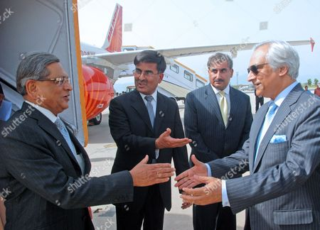 Pakistan's High Commissioner (ambassador) to India Shahid Malik (r) Shakes Hands with India's Foreign Minister S M Krishna Upon His Arrival at Chaklala Airbase in Rawalpindi Pakistan on 14 July 2010 S M Krishna Arrived in Rawalpindi on 14 July on an Official Visit with High Hopes on Both Sides to Revive the Political Level Dialogue Process Which Had Been Stalled After the Mumbai Terrorist Attacks in 2008 Pakistan Rawalpindi