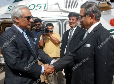 Pakistan's High Commissioner (ambassador) to India Shahid Malik (l) Shakes Hands with India's Foreign Minister S M Krishna Upon His Arrival at Chaklala Airbase in Rawalpindi Pakistan on 14 July 2010 S M Krishna Arrived in Rawalpindi on 14 July on an Official Visit with High Hopes on Both Sides to Revive the Political Level Dialogue Process Which Had Been Stalled After the Mumbai Terrorist Attacks in 2008 Pakistan Rawalpindi