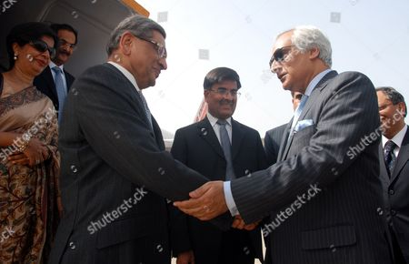 Pakistan's High Commissioner (ambassador) to India Shahid Malik (r) Shakes Hands with India's Foreign Minister S M Krishna (2-l) As Indian Foreign Secretary Nirupama Rao (l) Looks on Upon Their Arrival at Chaklala Airbase in Rawalpindi Pakistan on 14 July 2010 S M Krishna Arrived in Rawalpindi on 14 July on an Official Visit with High Hopes on Both Sides to Revive the Political Level Dialogue Process Which Had Been Stalled After the Mumbai Terrorist Attacks in 2008 Pakistan Rawalpindi