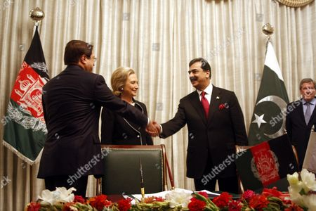 Anwar-ul-haq Ahady (l) Afghanistan's Commerce Minister Shakes Hands with Pakistan's Prime Minister Yousuf Raza Gilani As Us Secretary of State Hillary Clinton (2-l) Looks on During a Ceremony in Which Pakistan and Afghanistan Signed Transit-trade Agreements in Islamabad Pakistan on 18 July 2010 Hillary Clinton is on an Official Visit of Pakistan to Discuss Issues of Mutual Interest with Pakistani Leadership Pakistan Islamabad