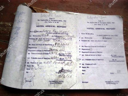 A Picture of Hotel Entry Register Showing Details of Gary Faulkner a Us Citizen who Stayed There Following His Arrest by the Pakistani Security Agencies in Broon Village of Kalash Valley Pakistan 17 June 2010 Gary Brooks Faulkner a Us Citizen and a Construction Worker was Arrested in Chitral Valley Pakistan Armed with a Samurai Sword a Pistol and Night-vision Goggles He Told Investigators on 15 June 2010 That He Wanted to Kill Osama Bin Laden to Avenge the 2001 Terrorist Attacks on the Us Pakistan Chitral