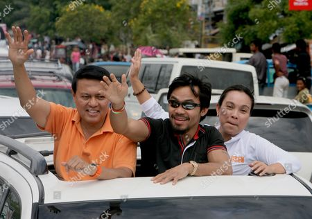 Philippine Presidential Candidate and World Boxing Champion Manny Pacquiao (c) and Vice Presidential Candidate Loren Legarda (r) and Nacionalista Party Standard-bearer Manny Villar (l) Wave to Supporters While Riding in a Motorcade During the First Day of Political Campaign in Sarangani General Santos City South of Manila Philippines on 26 March 2010 in One of Asia's Most Vibrant Democracies the Polls on 10 May Also Offered Hope For Change Following Nine Years of Rule Under President Gloria Arroyo That Have Been Marred by Allegations of Corruption and Vote Cheating Philippines Mnl