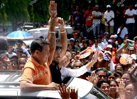 Philippine Presidential Candidate and World Boxing Champion Manny Pacquiao (c) and Vice Presidential Candidate Loren Legarda (r) and Nacionalista Party Standard-bearer Manny Villar (l) Wave to Supporters While Riding in a Motorcade During the First Day of Political Campaign in Sarangani General Santos City South of Manila Philippines on 26 March 2010 in One of Asia's Most Vibrant Democracies the Polls on 10 May Also Offered Hope For Change Following Nine Years of Rule Under President Gloria Arroyo That Have Been Marred by Allegations of Corruption and Vote Cheating Epa/val Handumon Philippines Mnl
