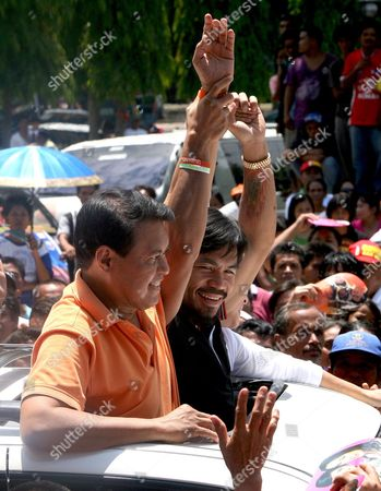 Philippine Presidential Candidate and World Boxing Champion Manny Pacquiao (c) and Vice Presidential Candidate Loren Legarda (back) and Nacionalista Party Standard-bearer Manny Villar (front) Wave to Supporters While Riding in a Motorcade During the First Day of Political Campaign in Sarangani General Santos City South of Manila Philippines on 26 March 2010 in One of Asia's Most Vibrant Democracies the Polls on 10 May Also Offered Hope For Change Following Nine Years of Rule Under President Gloria Arroyo That Have Been Marred by Allegations of Corruption and Vote Cheating Philippines Mnl