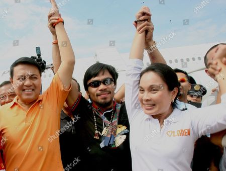 Philippine Presidential Candidate and World Boxing Champion Manny Pacquiao (c) and Vice Presidential Candidate Loren Legarda (r) and Nacionalista Party Standard-bearer Manny Villar (l) During the First Day of Political Campaign in Sarangani General Santos City South of Manila Philippines on 26 March 2010 in One of Asia's Most Vibrant Democracies the Polls on 10 May Also Offered Hope For Change Following Nine Years of Rule Under President Gloria Arroyo That Have Been Marred by Allegations of Corruption and Vote Cheating Philippines Mnl