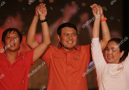Presidential Candidate Senator Manny Villar (c) Raises Arms with Senatorial Candidate Bongbong Marcos (l) and Vice-presidential Candidate Loren Legarda (r) During an Evening Campaign Rally in Manila Philippines 07 May 2010 Villar is One of the Top Three Among Nine Presidential Candidates in Polling Surveys For the Country's Top Political Post As Close to 50 Million Filipinos Are Set to Vote For New Leadership in the 10 May National Elections Philippines Manila