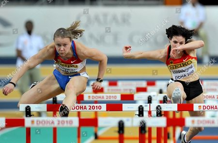 Nadine Hildebrand of Germany (r) and Tatyana Dektyareva of Russia Compete in the 60 Metres Hurdles Women's Semi-final During Second Day of the Iaaf World Indoor Championships Doha 2010 at the Aspire Dome in Doha Qatar on 13 March 2010 Qatar Doha