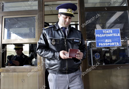 A Romanian Customs Official Checks a Passport at the Border with Moldova in Albita Some 360 Km Northeast of Bucharest Romania On 08 April 2009 Moldova Closed Its Border Crossings with Romania On 08 April Restricting Passage Only to Moldovan Citizens Living in Nearby Romanian Towns Romanian Customs Authorities Said Moldova's Communist Authorities Regained Control of Parliament and the Presidential Buildings From Protesters Earlier in the Day and Blamed Romania For Being Involved in the Violences