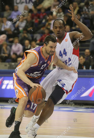Rafa Martinez (l) of Valencia Drives to the Basket As Jamont Gordon (r) of Cska Moscow Tries to Stop Him During Euroleague Group D Match in Moscow Russia 08 December 2010 Russian Federation Moscow
