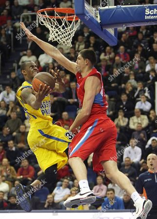 Viktor Kharyapa (r) of Cska Moscow Fights For the Ball with Daniel Ewing (l) of Asseco Prokom During the Euroleague Basketball Match Between Cska Moscow and Asseco Prokom in Moscow Russia 10 February 2010 Russian Federation Moscow