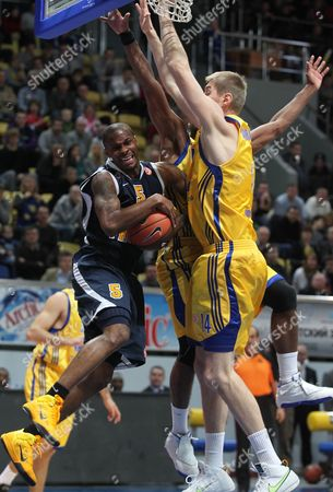 Alexey Savrasenko (r) and Keith Langford (r-beck) of Bc Khimki Fight For the Ball with Daniel Ewing (l) of Asseco Prokom During Their Euroleague Group a Basketball Match in Khimki Moscow Region Russia 20 October 2010 Russian Federation Khimki