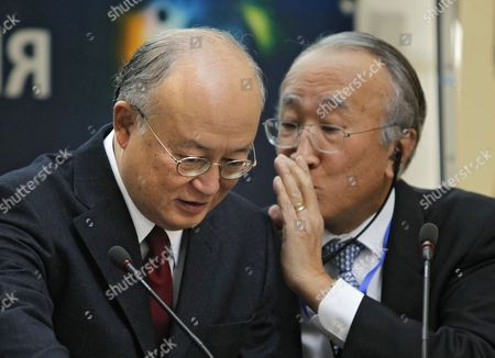 Director General of the International Atomic Energy Agency (iaea) Japanese Yukiya Amano (l) Listens to the Iaea Executive Director Nobuo Tanaka (r) During the International Energy Week in Moscow Russia 25 October 2010 Russian Federation Moscow