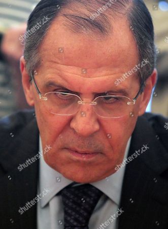 Stock Image of Russian Foreign Minister Sergei Lavrov Listens to Un Special Envoy on Libya Abdelilah Al-khatib (unseen) During Their Meeting in Moscow Russia 16 May 2011 Russian Federation Moscow