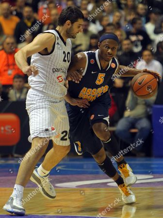 Stock Image of Daniel Ewing of Asseco Prokom (r) Challenges For the Ball with Petar Bozic (l) of Partizan Belgrade During Their Euroleague Group a Basketball Match in Belgrade Serbia 15 December 2010 Serbia and Montenegro Belgrade