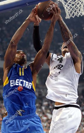 Alan Anderson (l) of Bc Maccabi Electra in Action Against Lawrence Roberts (r) of Bc Partizan Belgrade During Their Euroleague Basketball Quarterfinal Match in Belgrade Serbia 30 March 2010 Serbia Belgrade