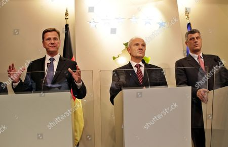 German Foreign Minister Guido Westerwelle (l) Kosovo's President Fatmir Sejdiu (c) and Kosovo's Prime Minister Hashim Thaci (r) Talk to Media Following Their Meeting in Pristina Kosovo 27 August 2010 Serbia and Montenegro Pristina