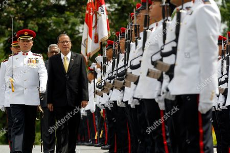 Philippine President Benigno Aquino Ii (2-l) Leads Singaporean President Sr Nathan (back) During and Honor Guard Inspection at Istana the Official Residence and Office of the President of Singapore on 10 March 2010 President Aquino is on a Three Day Visit to the Island Nation Singapore Singapore