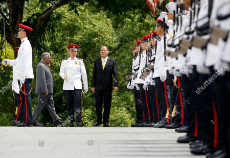 Philippine President Benigno Aquino Ii (4-l) Leads Singaporean President Sr Nathan (2-l) During and Honor Guard Inspection at Istana the Official Residence and Office of the President of Singapore on 10 March 2010 President Aquino is on a Three Day Visit to the Island Nation Singapore Singapore