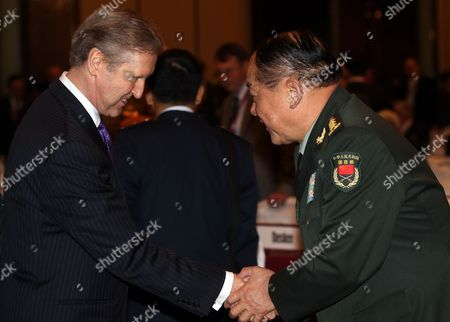 General Liang Guanglie (r) Chinese Minister of National Defense Greets Former American Secretary of State William Cohen During the Shangri-la Dialogue in Singapore on 04 June 2011 Singapore Singapore