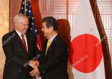 Us Secretary of Defence Robert Gates (l) Shakes Hands with Japan's Minister of Defence Toshimi Kitazawa During a Bilateral Meeting in Singapore 03 June 2011 the Us is not Trying to Hold China Down Or Block It As a Global Power Defence Secretary Robert Gates Has Said As He Flew to an Asian Security Conference in Singapore Which Will Include a Delegation Led by China's Defence Minister Liang Guanglie Singapore Singapore