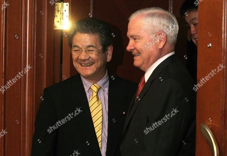 Us Secretary of Defence Robert Gates (r) and Japan's Minister of Defence Toshimi Kitazawa Enter a Bilateral Meeting in Singapore 03 June 2011 the Us is not Trying to Hold China Down Or Block It As a Global Power Defence Secretary Robert Gates Has Said As He Flew to an Asian Security Conference in Singapore Which Will Include a Delegation Led by China's Defence Minister Liang Guanglie Singapore Singapore