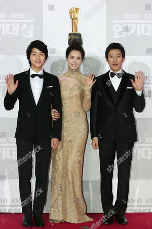 Stock Photo of South Korean(l-r) Actor Song Joong-ki From the Kbs Drama 'Sungkyunkwan Scandal' Actress Lee Da-hae who Appeared on the Screen 'The Slave Hunters' and Actor Choi Soo-jong who Appeared on the Screen 'President' Arrive For the 2010 Annual Kbs Drama Awards at the Youido Kbs Hall in Seoul South Korea 31 December 2010 the Kbs Drama Awards Ceremony Gives a Prize to Actors and Actresses who Have Stared in Dramas by Kbs This Awards Started in 1987 and Has Been Going on Ever Since Korea, Republic of Seoul