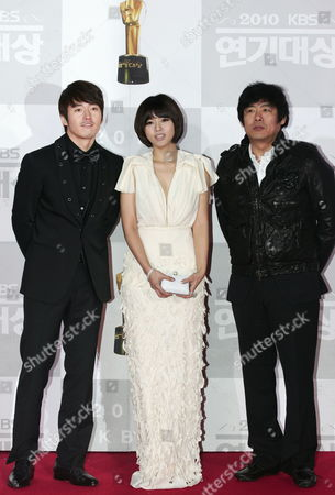 South Korean(l-r) Actor Jang-hyuk Actress Oh Ji-eun and Actor Sung Dong-il From the Kbs Drama 'The Slave Hunters' Arrive For the 2010 Annual Kbs Drama Awards at the Youido Kbs Hall in Seoul South Korea 31 December 2010 the Kbs Drama Awards Ceremony Gives a Prize to Actors and Actresses who Have Stared in Dramas by Kbs This Awards Started in 1987 and Has Been Going on Ever Since Korea, Republic of Seoul