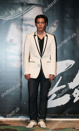 South Korean Rapper and Actor Choi Seung-hyun (aka T O P) Poses For Photographs As He Attends the Premiere of the Film 'Into the Fire' at the Lotte Cinema in Seoul South Korea 03 June 2010 the Film Directed by John H Lee Will Be Released on 16 June in South Korea Korea, Republic of Seoul