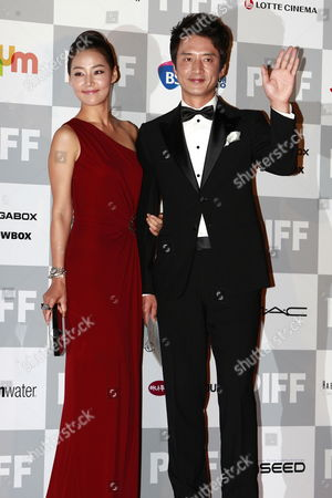 South Korean Actress Han Ji-hye (l) and Actor Chung Jun-ho (r) Arrive at the Opening Ceremony of the 15th Pusan International Film Festival in Busan South Korea 07 October 2010 the Asian Film Festival Showcases 308 Films From 67 Countries and Runs From 07 October 2010 to 15 October 2010 Korea, Republic of Busan