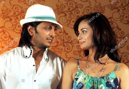 Indian Actors Ritesh Deshmukh (l) and Dia Mirza (r) Attend a Press Conference During the Indian International Film Academy Awards (iifa) Ceremony in Colombo Sri Lanka 03 June 2010 Bollywood Celebrities Are to Play a Celebrity Cricket Match Against Sri Lanka Cricket Captain Kumar Sangakkara's Team at the Sinhalese Sports Club (ssc) Grounds on 04 June to Raise Funds For Reintegrating Former Child Soldiers Into Their Communities a Unicef Initiative 'Cricket For Children' Will Receive the Major Part of the Proceeds the Iifa Running From 03 to 05 June is Being Held in the Island Nation As a Tourism Promotion Event Sri Lanka Colombo