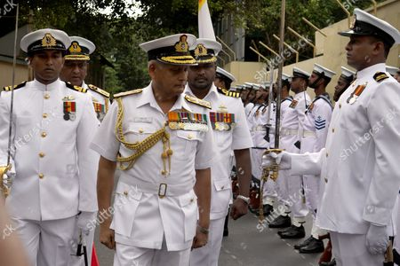 India's Chief of Naval Staff Admiral Nirmal Verma (c) Inspects the Troops During the Guard of Honour Accorded Him at the Sri Lanka Navy Headquarters in Colombo 28 June 2010 Admiral Verma who is a Specialist in Communication and Electronic Warfare with Nearly Four Decades of Experience in Various Afloat and Ashore Appointments is on a Brief Visit to Sri Lanka where He is to Visit the Northern Harbour of Kankasenthurai Trincomalee in the East and Also Meet Several Leaders and Civil Society India Being the Island's Giant Neighbour is Actively Involved in the Rehabilitation and Resettlement Process in the War Ravaged North and East Sri Lanka Colombo
