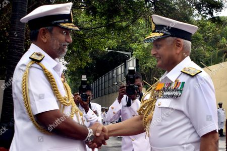India's Chief of Naval Staff Admiral Nirmal Verma (r) Greets Sri Lanka Navy Commander Vice Admiral Tissara Samarasinghe (l) During His Visit to the Island's Naval Headquarters in Colombo 28 June 2010 Admiral Verma who is a Specialist in Communication and Electronic Warfare with Nearly Four Decades of Experience in Various Afloat and Ashore Appointments is on a Brief Visit to Sri Lanka where He is to Visit the Northern Harbour of Kankasenthurai Trincomalee in the East and Also Meet Several Leaders and Civil Society India Being the Island's Giant Neighbour is Actively Involved in the Rehabilitation and Resettlement Process in the War Ravaged North and East Sri Lanka Colombo
