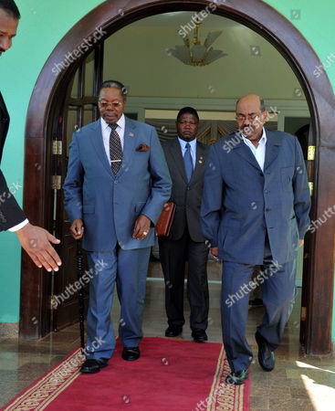 Sudanese President Omar Hassan Al-bashir (r) Walks with the Malawian President and African Union (au) Chairperson Bingu Wa Mutharika (l) Following Their Meeting in Khartoum Sudan 26 January 2011 Mutharika Arrived in Sudan 26 January on a Two-day Official Visit to the Country Sudan Khartoum
