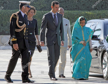 Syrian President Bashar Al-assad (c) Accompanies His Indian Counterpart Pratibha Devisingh Patil (r) For a Welcoming Ceremony at the Ash-shaeb Presidential Palace in Damascus Syria on 27 November 2010 President Patil is on a Four-day Visit to Syria the Second Leg of a Regional Tour That Took Her to the United Arab Emirates the Visit Came at the Invitation of President Al-assad and Both Leaders Are Expected to Discuss Bilateral Issues and Explore Investment Opportunities in Each Other's Country Seen in Background Are the Syrian President's Wife Asma Al-assad (2l) and Devisingh Ramsingh Shekawat (2r) the Husband of the Indian President Syrian Arab Republic Damascus