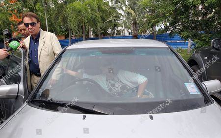 Stock Picture of Internationally Well-known Russian Pianist and Conductor Mikhail Pletnev (l) Charged with Raping a Boy Speaks to the Media As He Gets Into a Car After a Court Appearance at the Provincial Court in Pattaya Beach Resort City Chonburi Province Thailand 30 July 2010 Pletnev was Arrested by Thai Police Accused of Raping a 14-year-old Thai Boy if Found Guilty Pletnev Faces Up to 20 Years in Jail Mikhail Pletnev Denied the Pedophilia Charges by the Thai Authorities Thailand Pattaya