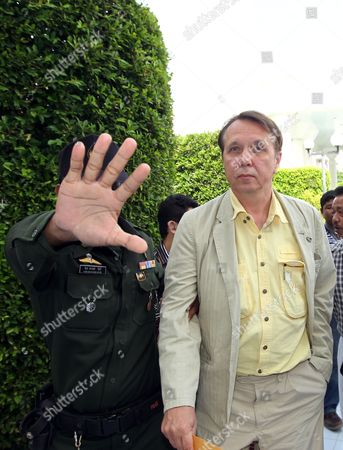 Internationally Well-known Russian Pianist and Conductor Founder and Music Director of the Russian National Orchestra Mikhail Pletnev (r) Alleged Child Abuser is Escorted by a Court Official As He Appears at a Provincial Court in Pattaya Beach Resort City Chonburi Province Thailand 19 July 2010 Pletnev was Arrested by Thai Police Accused of Raping a 14-year-old Thai Boy if Found Guilty Pletnev Faces Up to 20 Years in Jail Mikhail Pletnev Denied the Pedophilia Charges of Thai Authorities Thailand Pattaya
