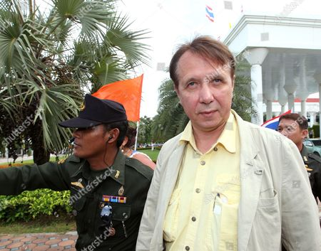 Internationally Well-known Russian Pianist and Conductor Founder and Music Director of the Russian National Orchestra Mikhail Pletnev (r) Alleged Child Abuser Appears at a Provincial Court in Pattaya Beach Resort City Chonburi Province Thailand 19 July 2010 Pletnev was Arrested by Thai Police Accused of Raping a 14-year-old Thai Boy if Found Guilty Pletnev Faces Up to 20 Years in Jail Mikhail Pletnev Denied the Pedophilia Charges of Thai Authorities Thailand Pattaya